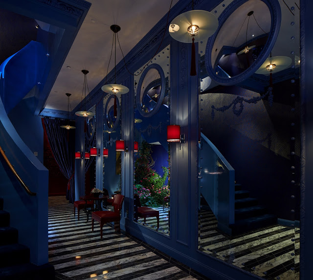 A swank blue entryway into the $49.5 million townhouse was designed by David Collins Studio. Photo by: Phillip Ennis